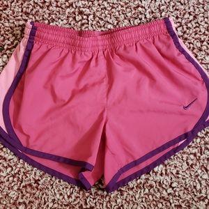 Girls pink Nike shorts.